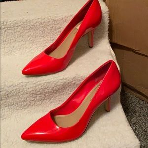 Gently used patent leather red heels